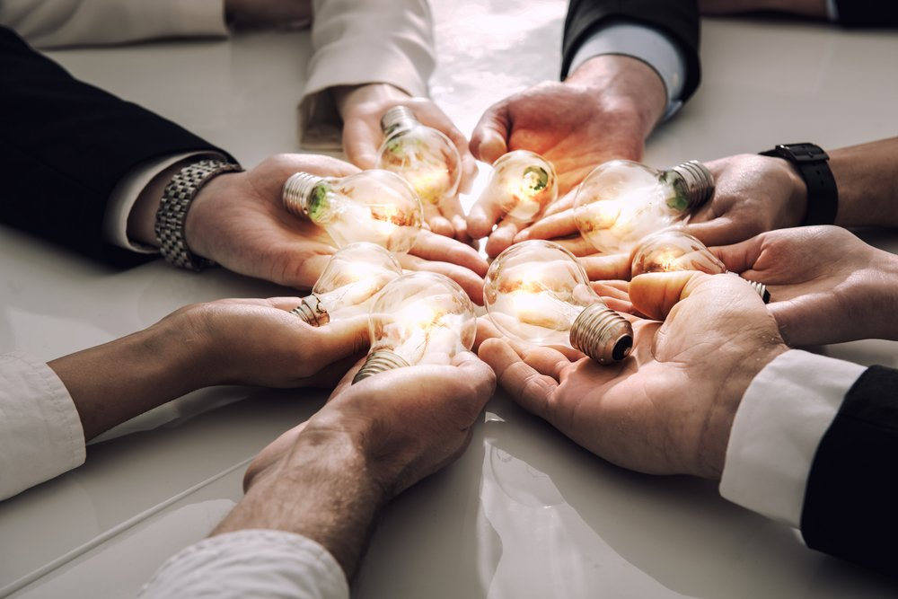 Teamwork,And,Brainstorming,Concept,With,Businessmen,That,Share,An,Idea