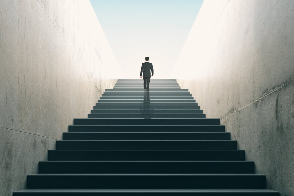 Ambitions,Concept,With,Businessman,Climbing,Stairs