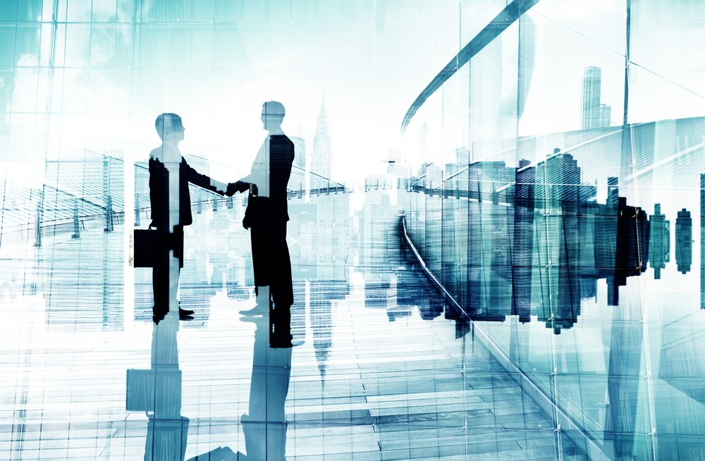 Silhouettes,Of,Two,Businessmen,Having,A,Handshake